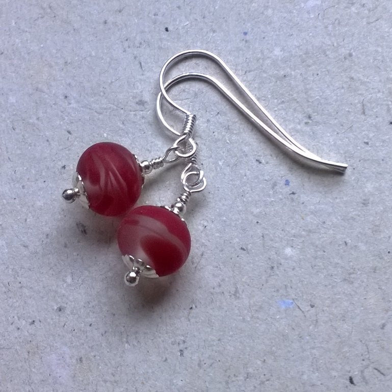 Etched red swirl fishhook