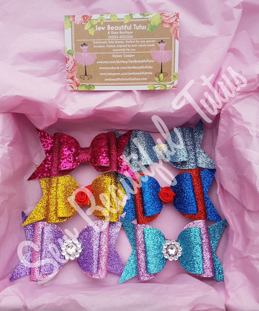 Free box of 6 glitter bows offer