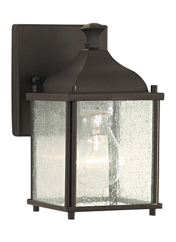 "OL4000ORB  This Oil Rubbed Bronze Wall Lantern from Feiss is part of the Terrace collection.  Horse and buggy lamps of yesteryear define the look of the Terrace outdoor lighting collection by Feiss. Featuring four panels of Seeded Clear glass within a slightly widening at-the-top body, the Oil Rubbed Bronze finishes this classic, antique look.  Oil Rubbed Bronze Dimensions: W: 4 1/2'' H: 8 1/4'' Glass: Seeded Lamping: (1) Medium A19 60w Max Extends 6"" Supplied with 8"" of wire Backplate: H: 5"" W: 4 1/2"" Bulb"