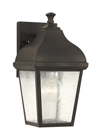 "OL4001ORB  This Oil Rubbed Bronze Wall Lantern from Feiss is part of the Terrace collection.  Horse and buggy lamps of yesteryear define the look of the Terrace outdoor lighting collection by Feiss. Featuring four panels of Seeded Clear glass within a slightly widening at-the-top body, the Oil Rubbed Bronze finishes this classic, antique look.  Oil Rubbed Bronze Dimensions: W: 6 1/2'' H: 11 3/4'' Glass: Seeded Lamping: (1) Medium A19 100w Max Extends 6 3/4"" Supplied with 8"" of wire Backplate: H: 4 1/2"" W: 6"