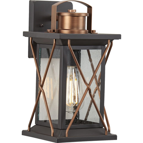 Transform your home into a warm and cozy dream with the friendly farmhouse-style of this small wall lantern. A rustic X-brace design decorates each side of the charming lantern silhouette. Clear seeded glass panes add an extra pop of rustic personality. An antique bronze finish complemented with antique copper accents adds warmth and character as the lantern infuses your home with gentle illumination.