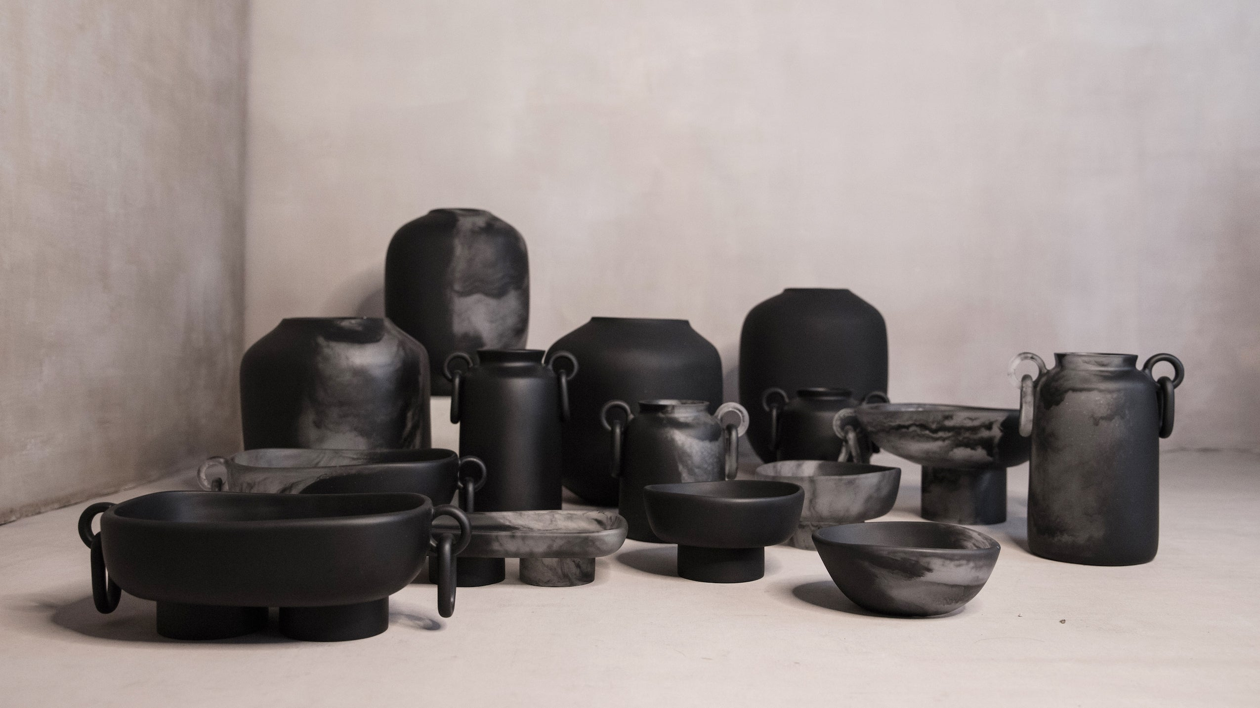 A group of black and transparent decor vases and bowls from baron y vicar