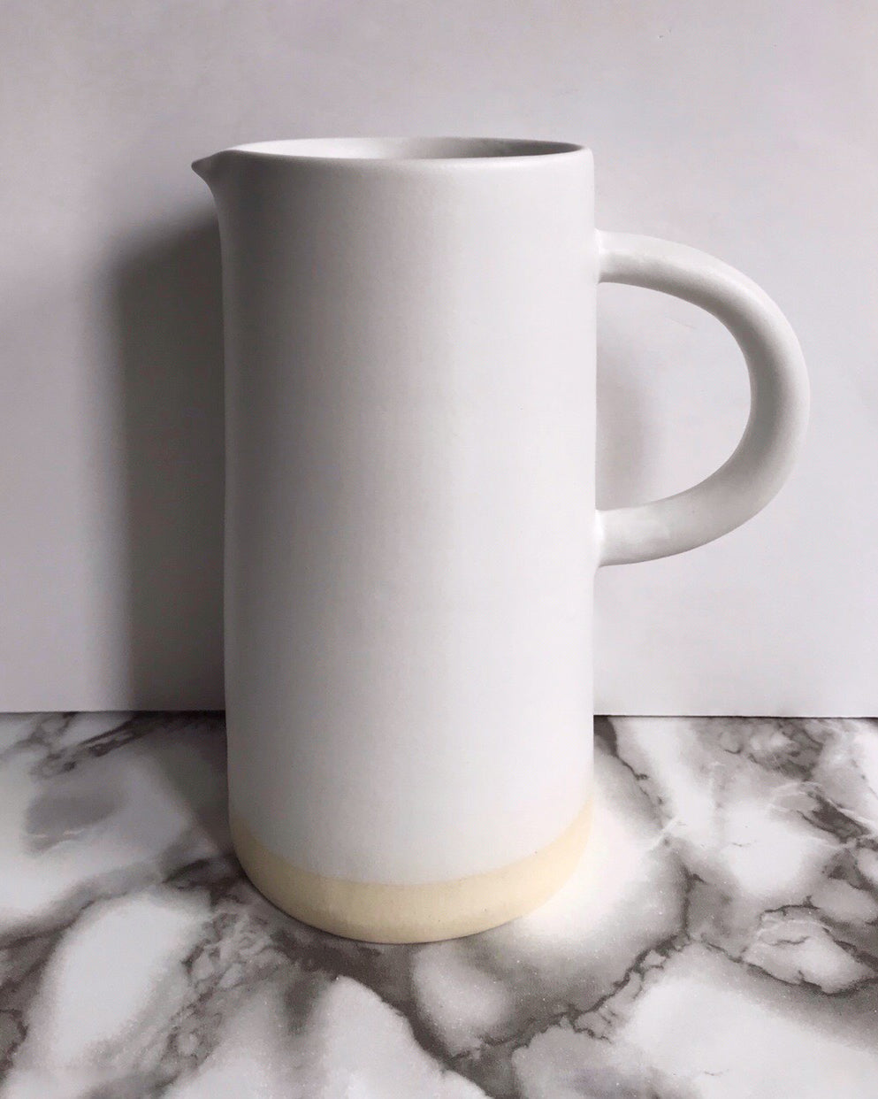 Handmade ceramic pitcher matte glaze white