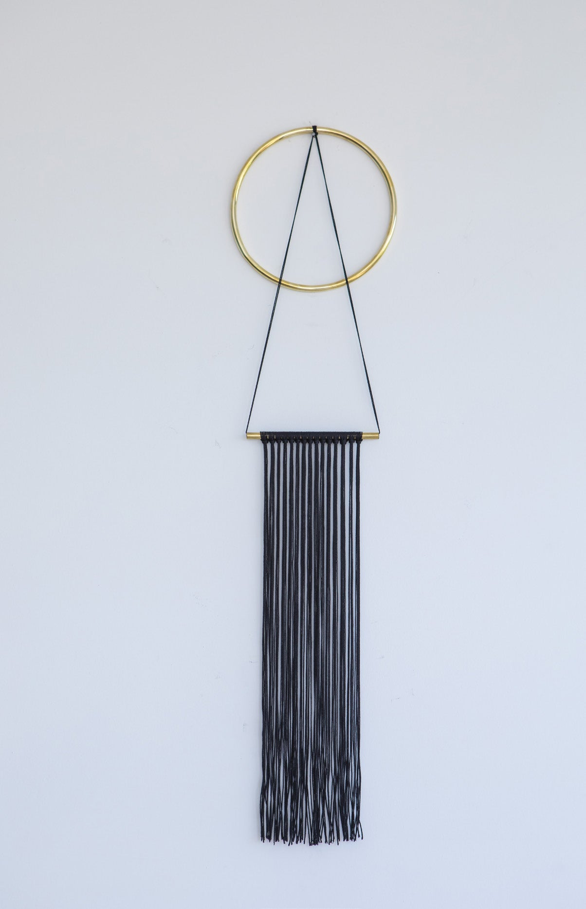Brass and nylon wall hanging black