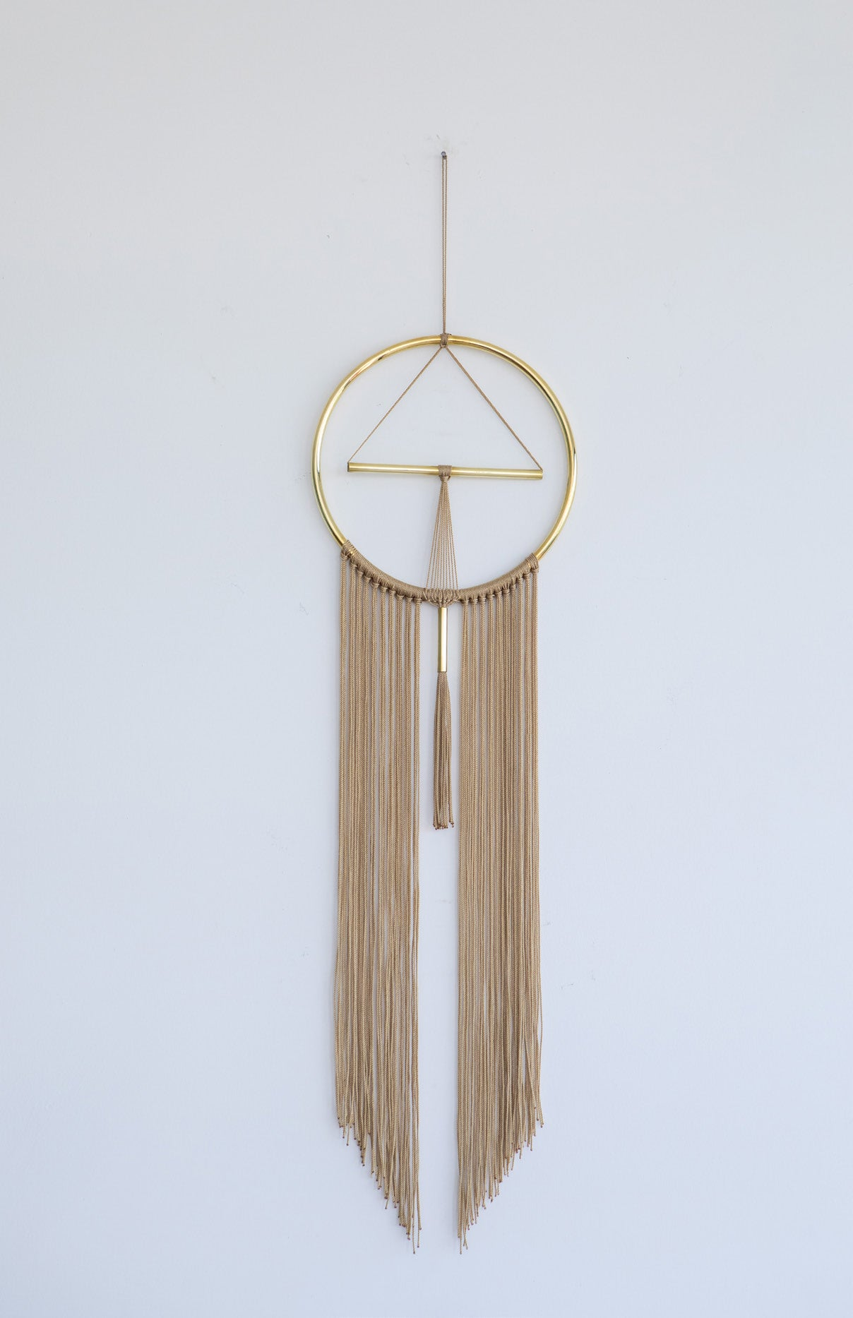 Brass and nylon wall hanging ochre golden