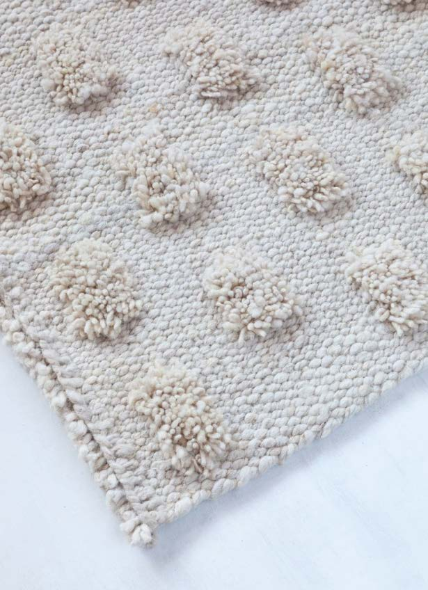 Handwoven wool rug natural