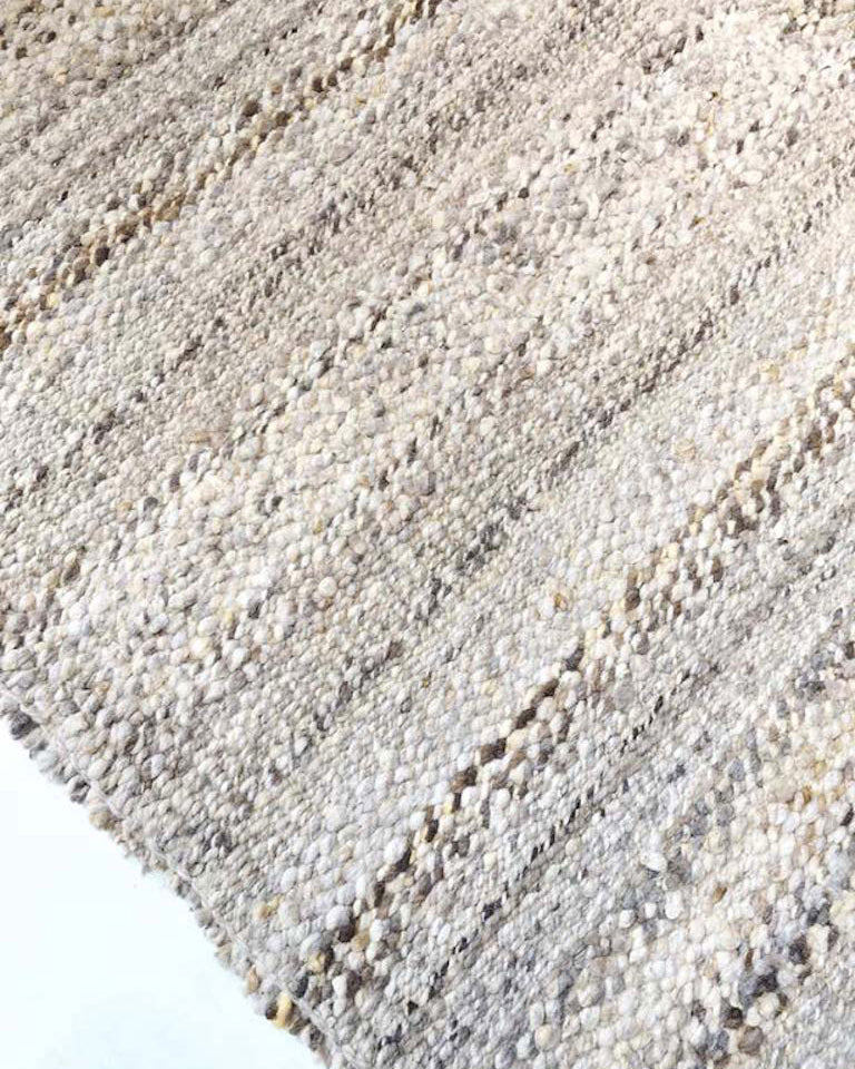 Handwoven undyed wool rug natural