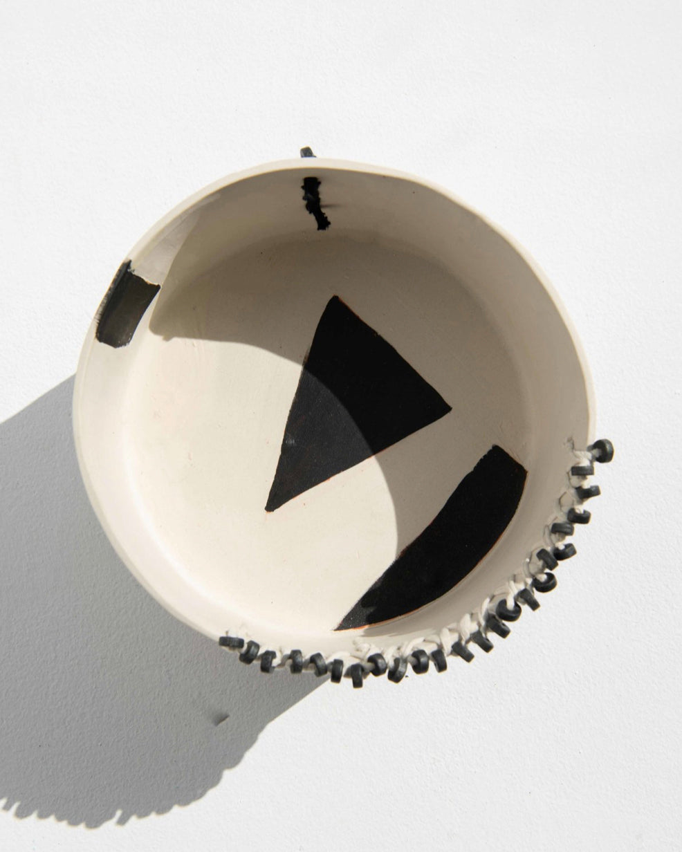 Handmade ceramic bowl with beads and fabric black and white