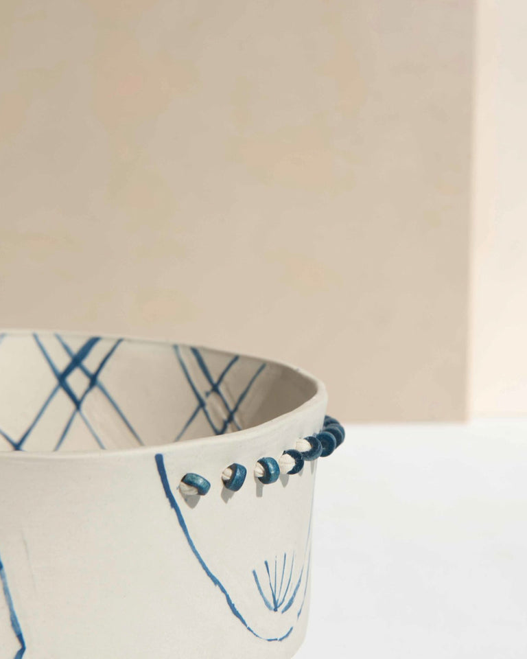 Handmade ceramic bowl white and blue with beads and fabric