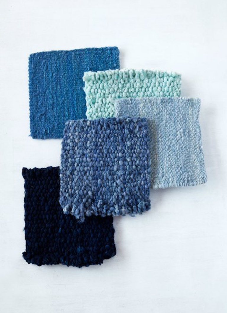 Handwoven wool rug color swatches blue