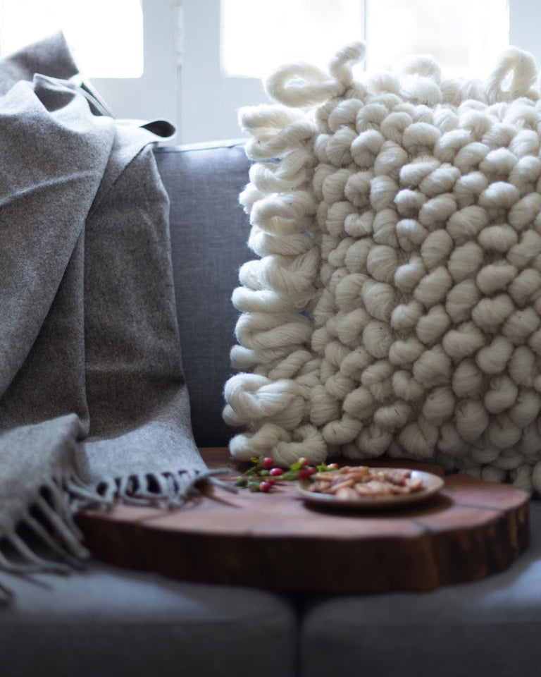 Handwoven wool pillow natural with knots