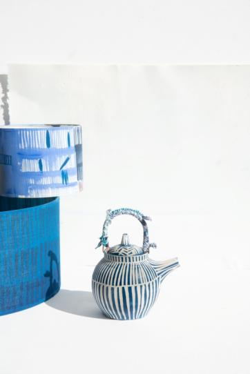 Handmade ceramic teapot blue and white with beads and fabric