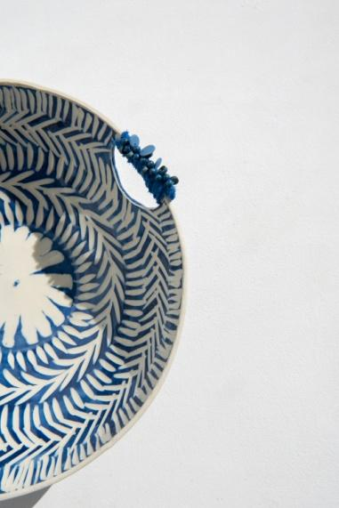 Handmade ceramic bowl blue and white with beads and fabric