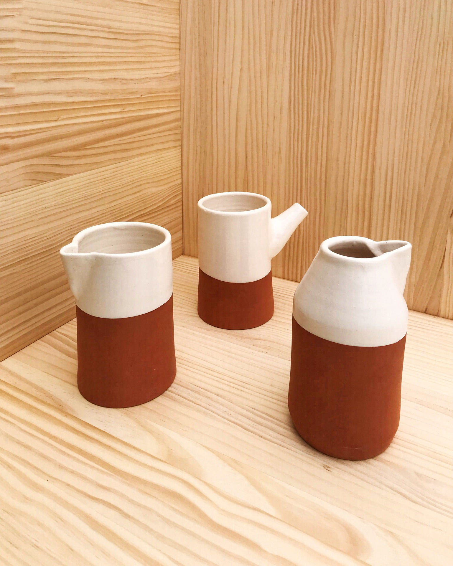 Handmade ceramic carafes terracota and white