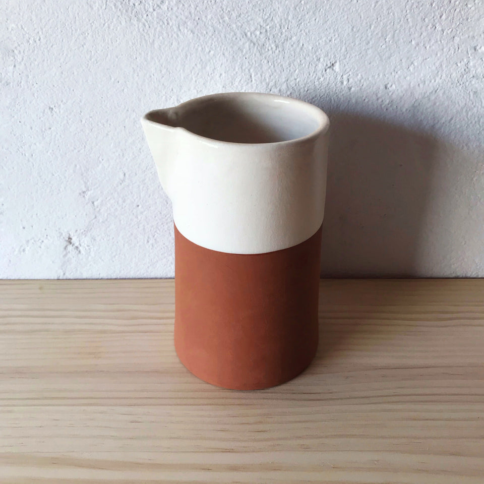 Handmade ceramic carafe terracota and white