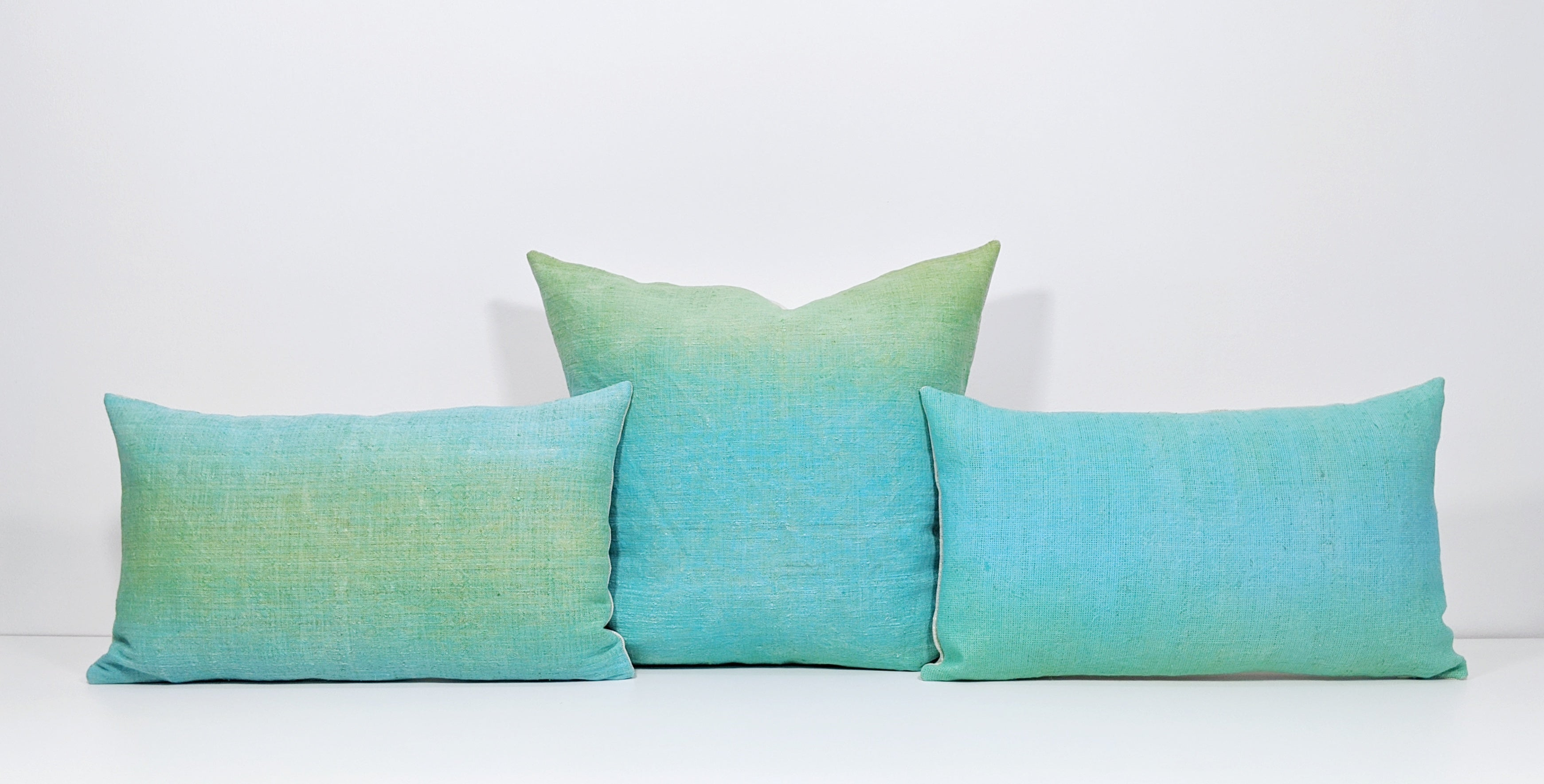Hand-painted vintage linen pillow neon blue green aqua