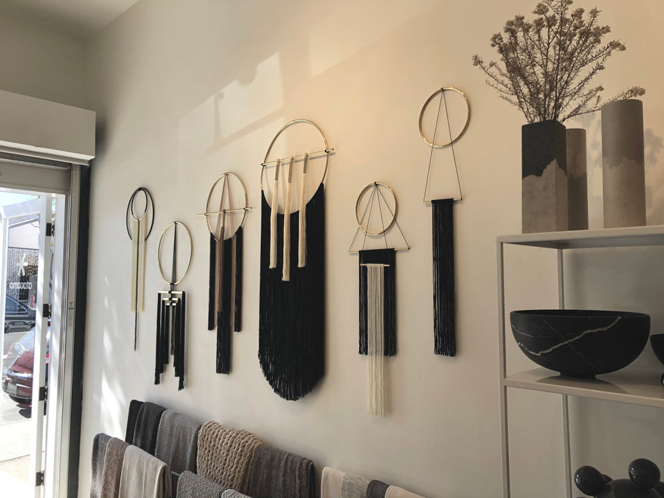 Brass and nylon wall hangings black and ochre brown
