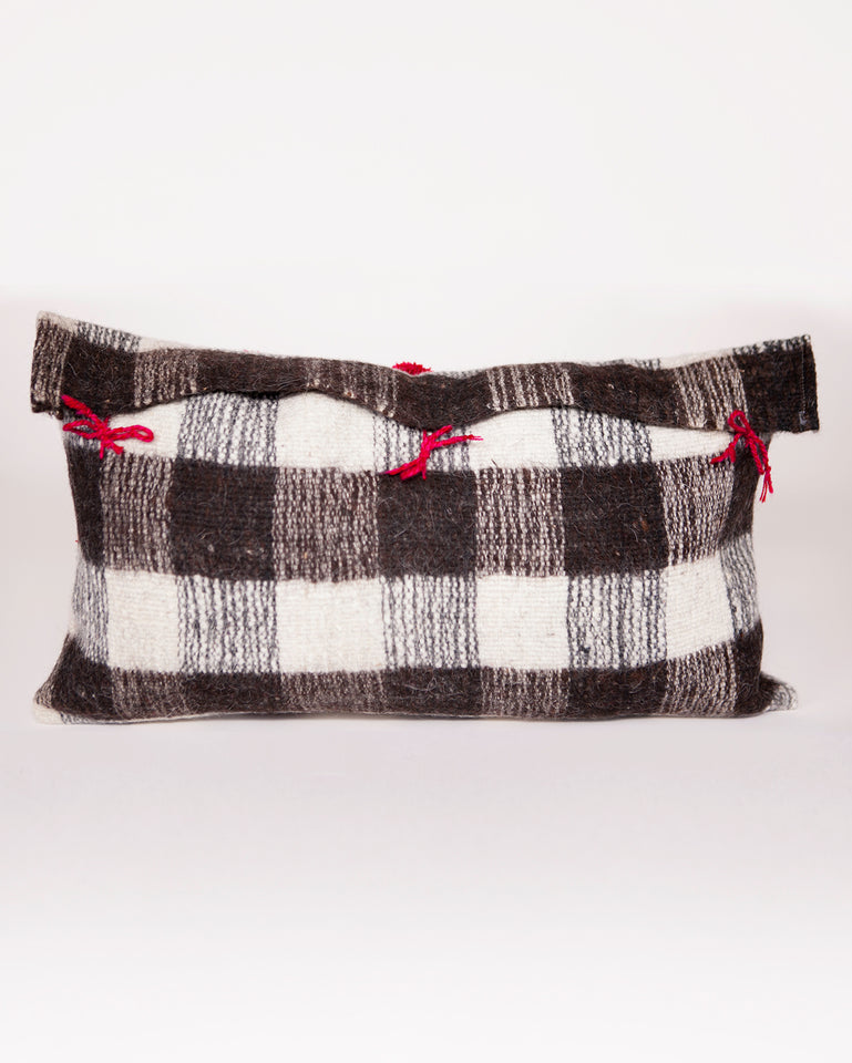 Handwoven wool pillow with red pompoms black and white B&W