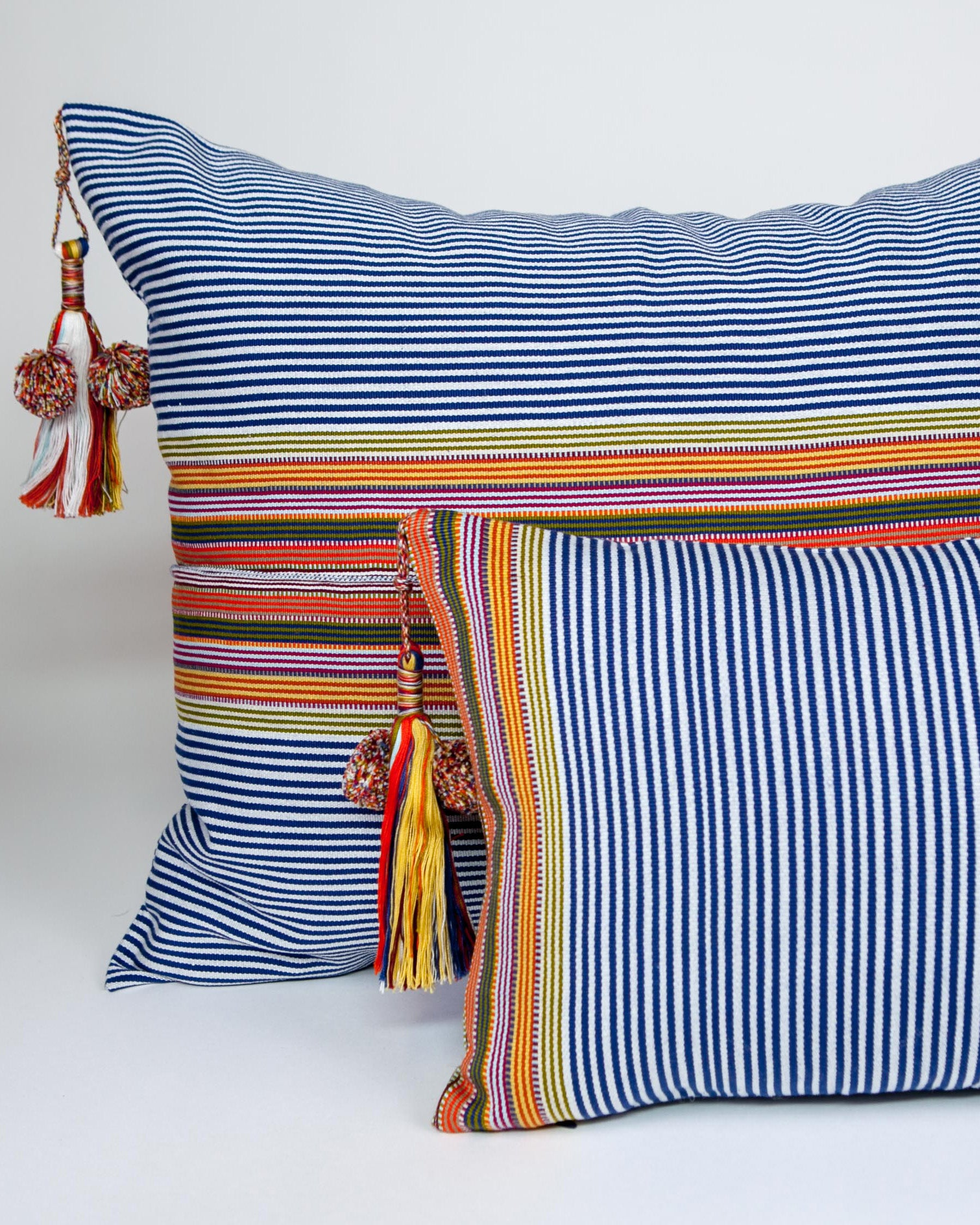 Handwoven cotton pillows with colored tassels blue and orange