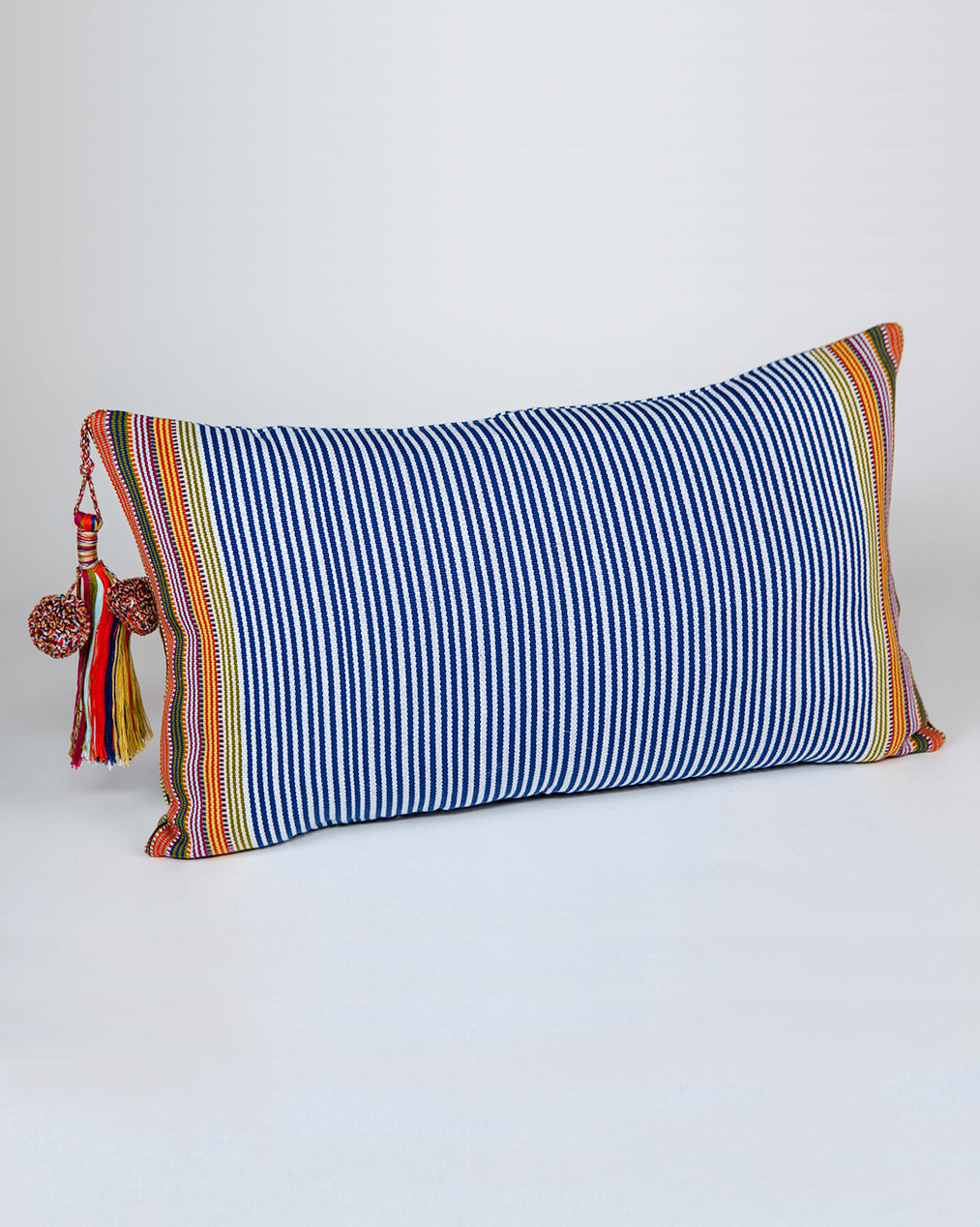 Handwoven cotton pillow with colored tassels blue and orange