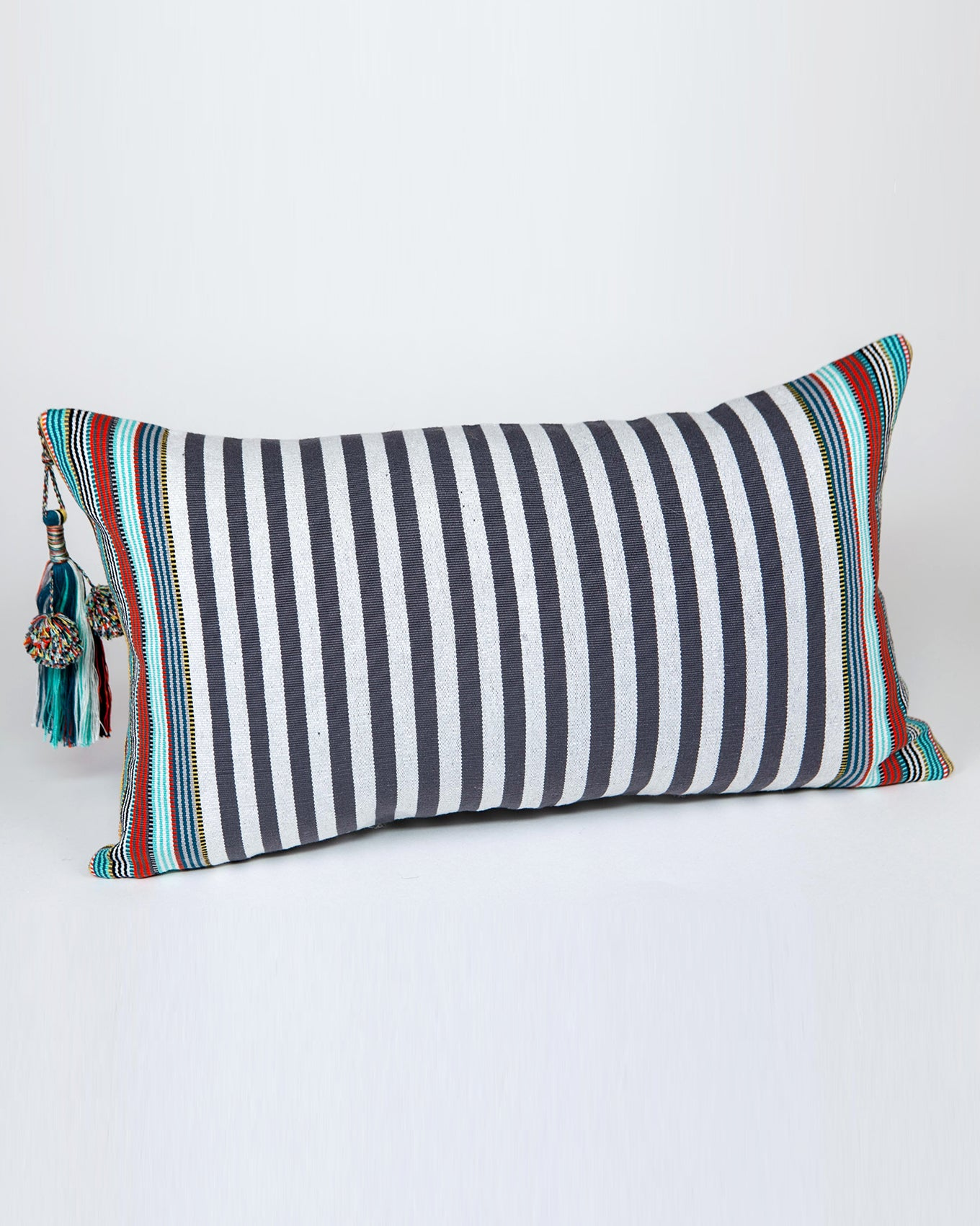 Handwoven cotton pillow grey and white with green stripes and colored tassels