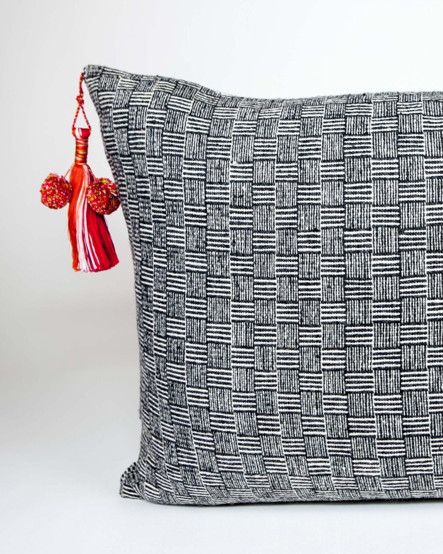 Handwoven wool pillow with colored tassels black and white B&W