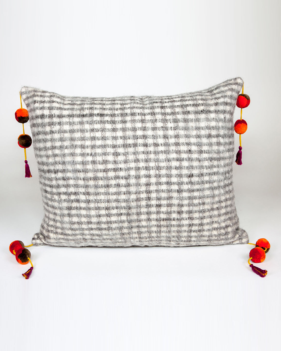 Handwoven wool pillow with colored pompoms white and grey