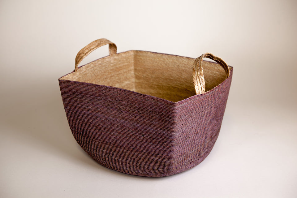 Handwoven palm basket with handles