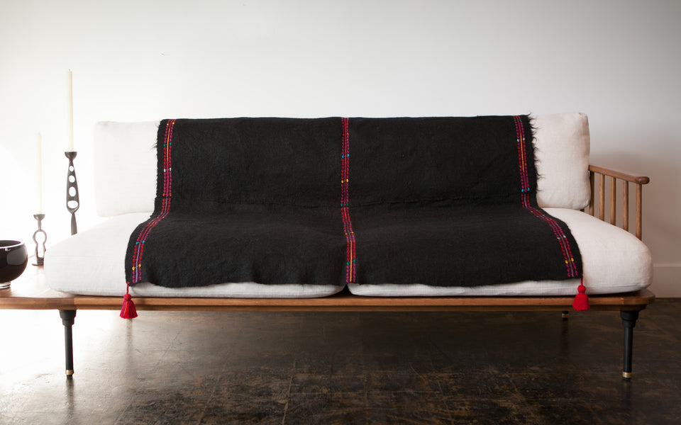 Handwoven wool throw black and red with tassels