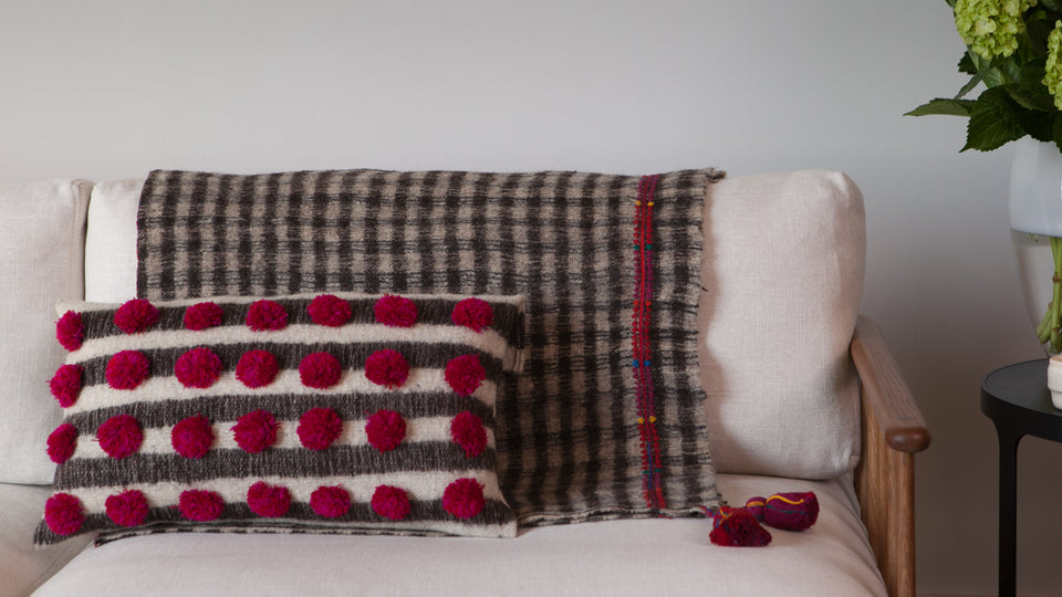 Handwoven wool throw with red tassels black and white checkered