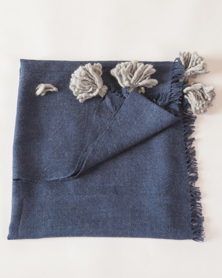 Handwoven merino wool blue throw with grey poms