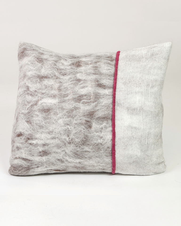 Hand-felted silk and wool pillow with red cochineal trim