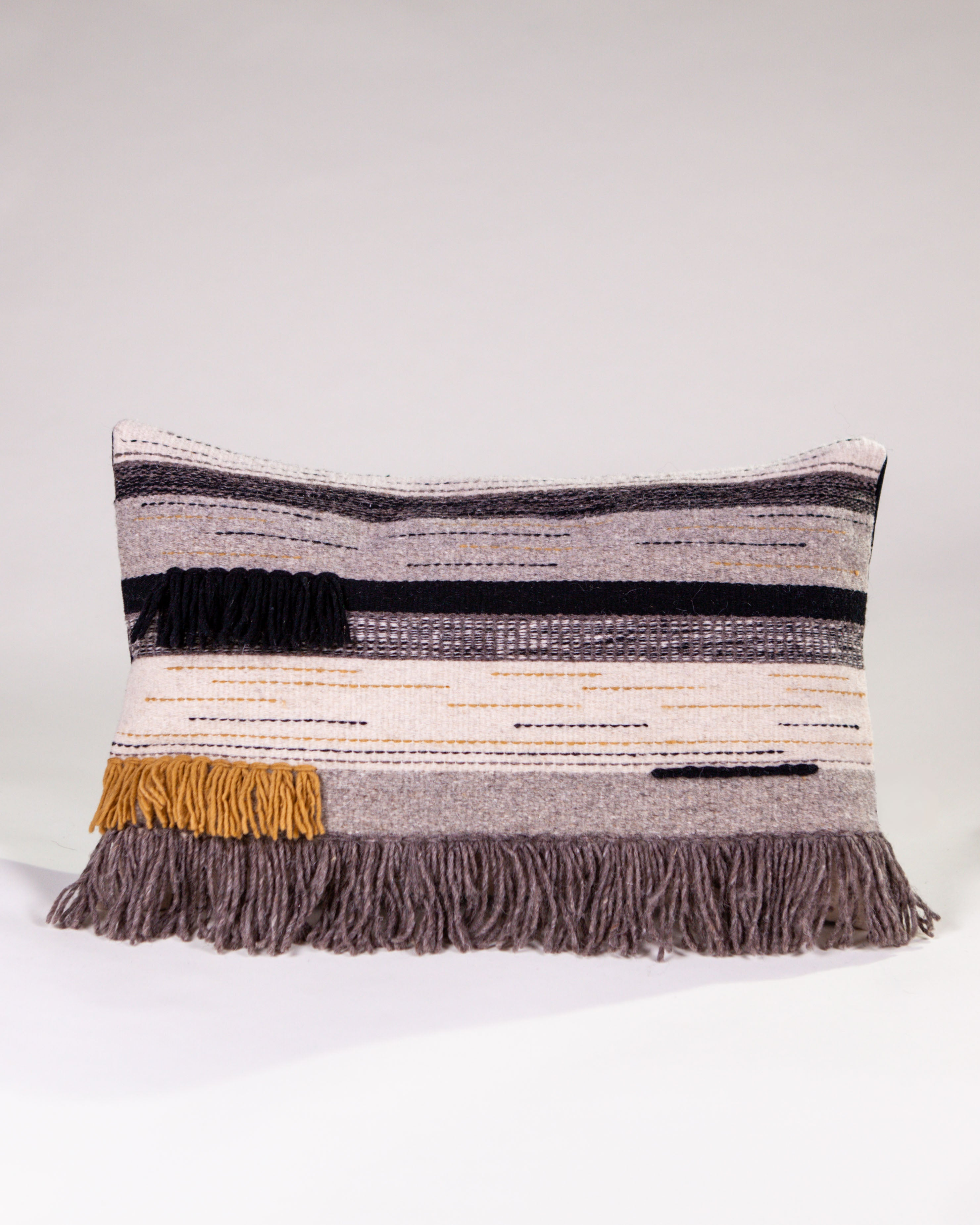 Handwoven wool pillow grey black yellow ochre with fringe
