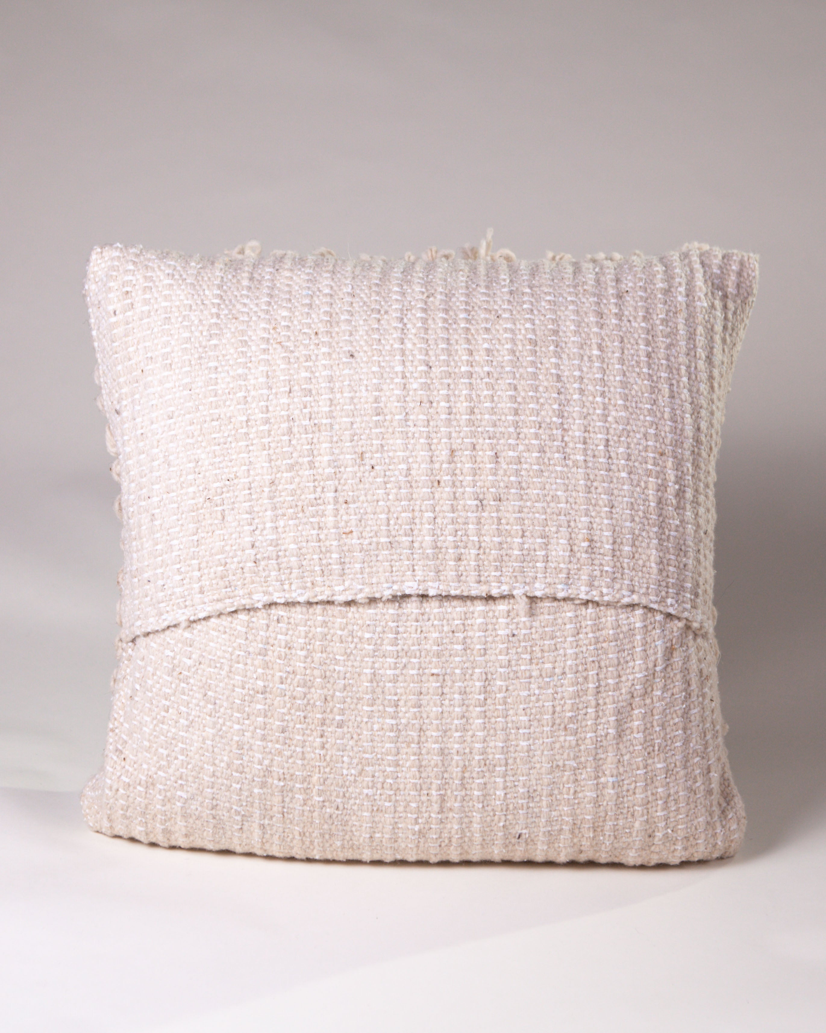 Handwoven wool pillow natural with knots and fringe