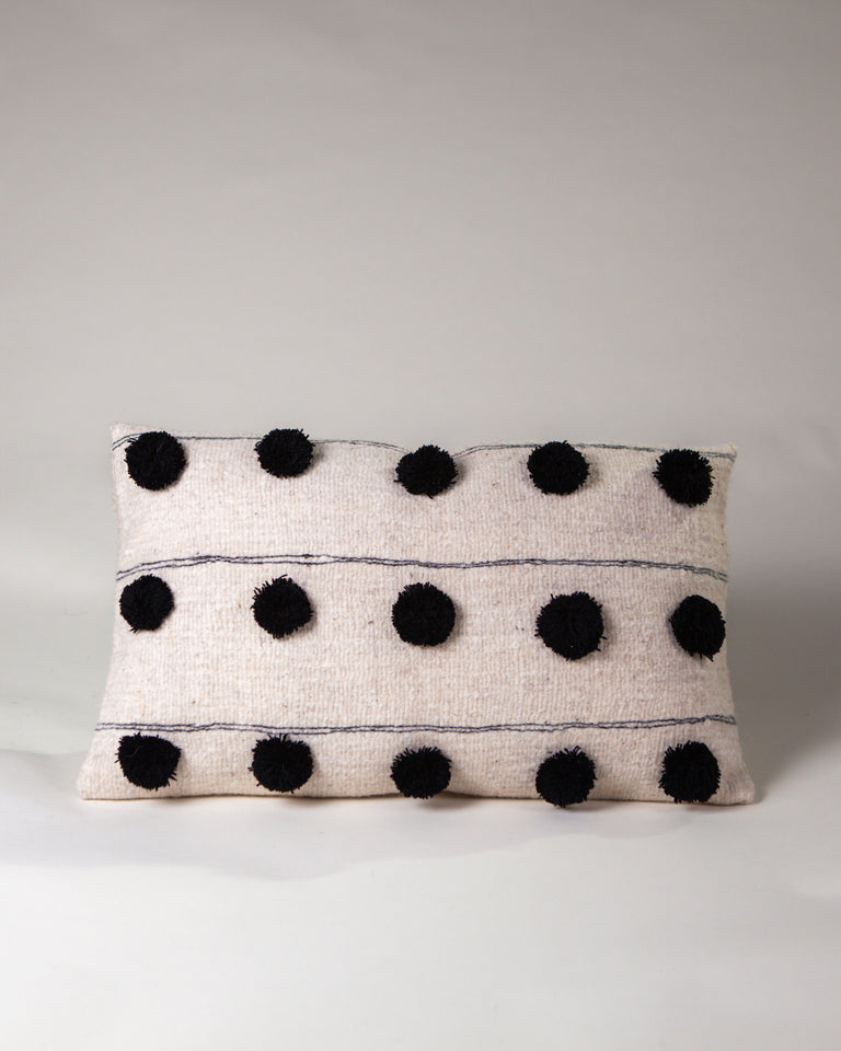 Handwoven wool pillow with black pompoms black and white B&W