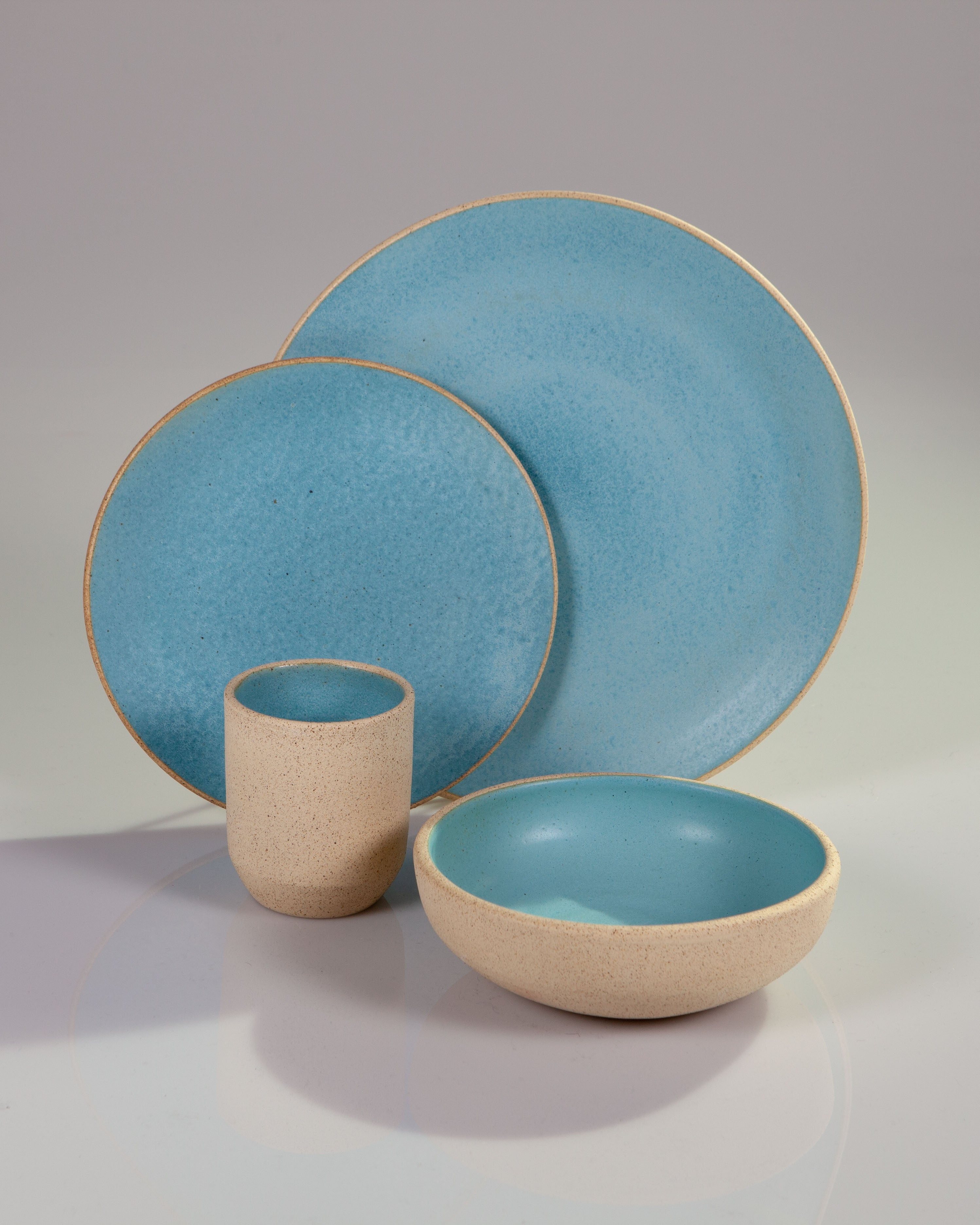 Handmade ceramic place setting plates bowl cup turquoise blue organic texture