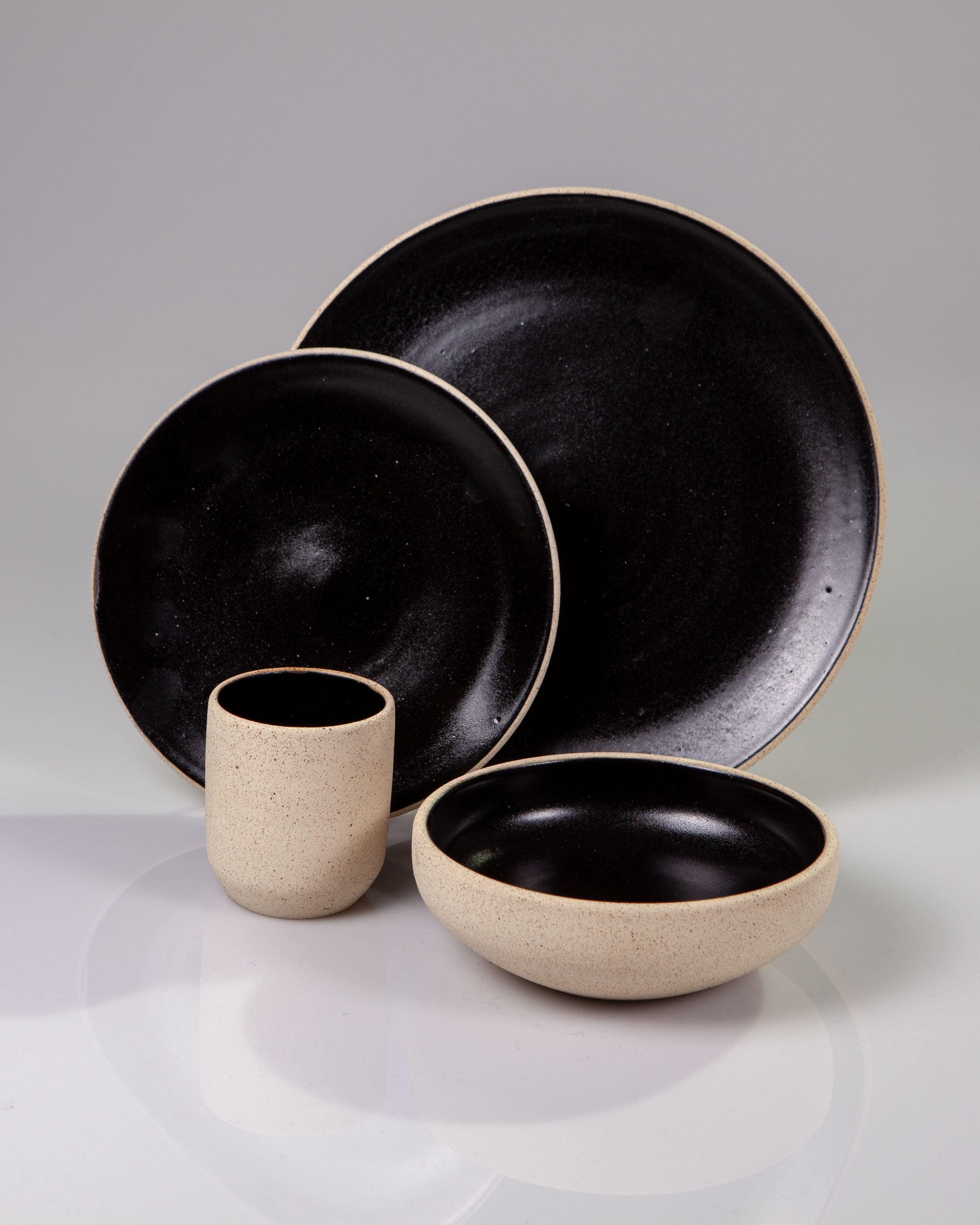 Handmade ceramic place setting plates cup bowl obsidian black organic texture