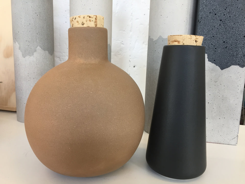 Handmade clay carafes containers with cork