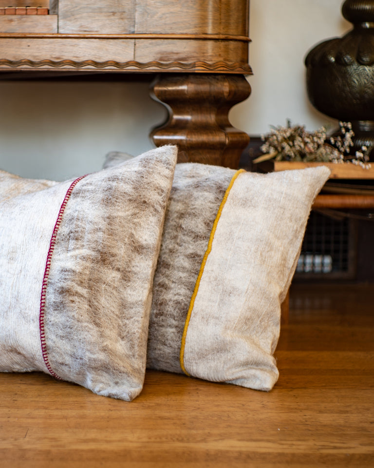 Hand-felted silk and wool pillows with red and yellow trim