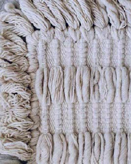 Handwoven wool rug natural with knots and fringe