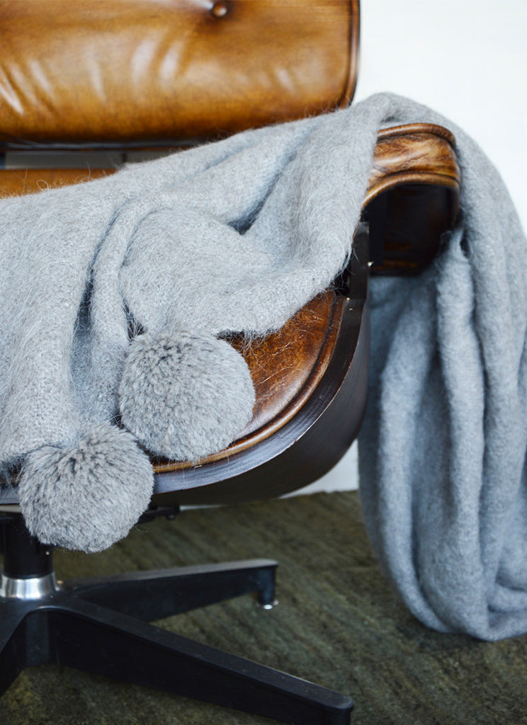 Handwoven llama wool throw silver grey pompoms