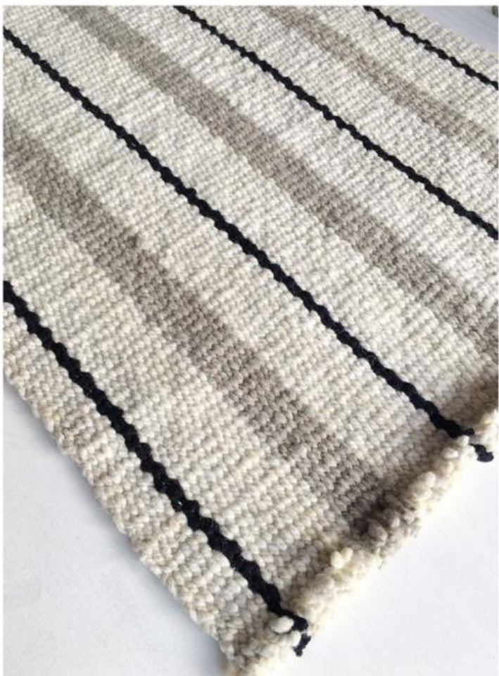 Handwoven wool rug black white and grey