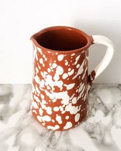 Handmade ceramic jug terracota and white