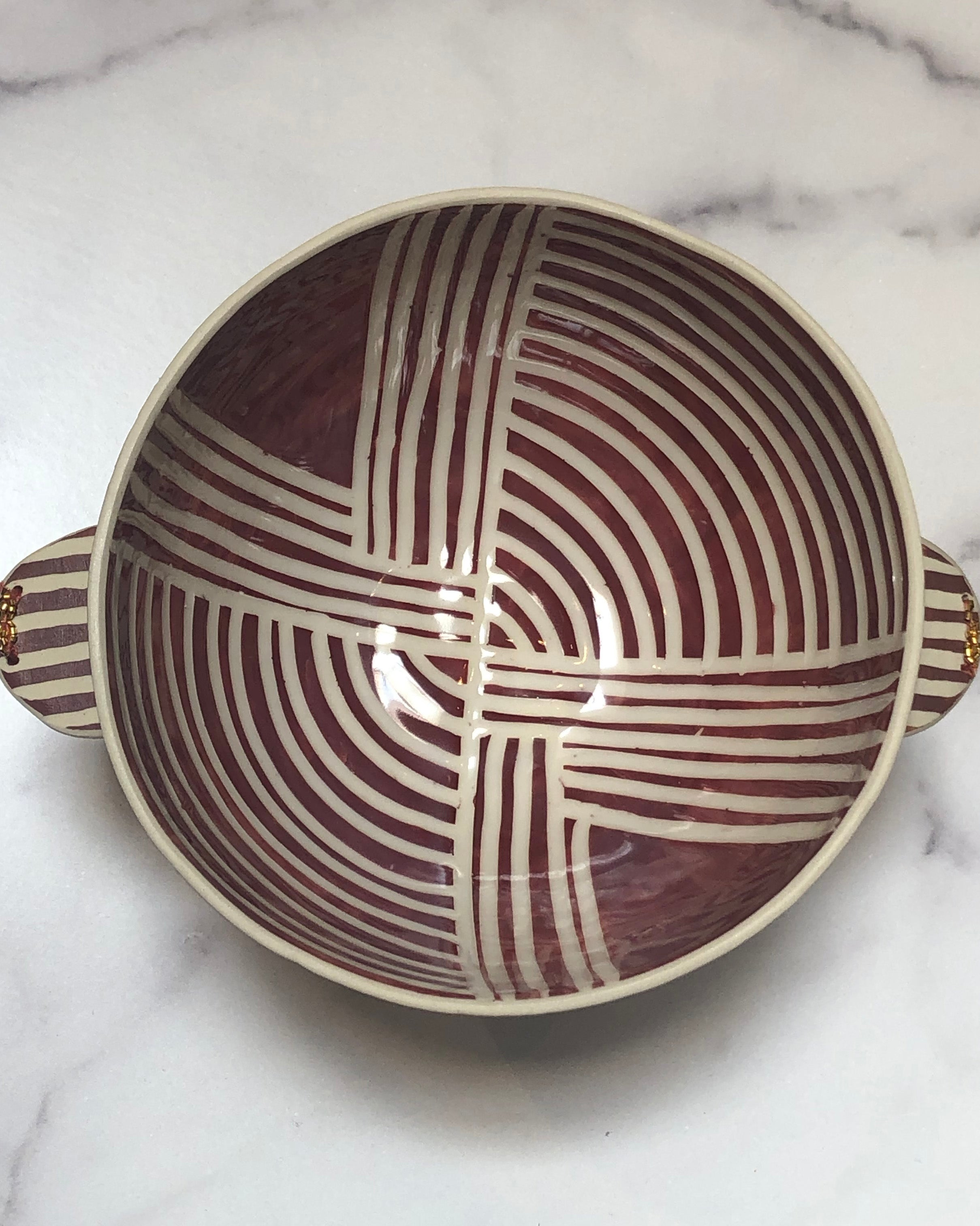 Handmade terracota fountain bowl with beads and fabric