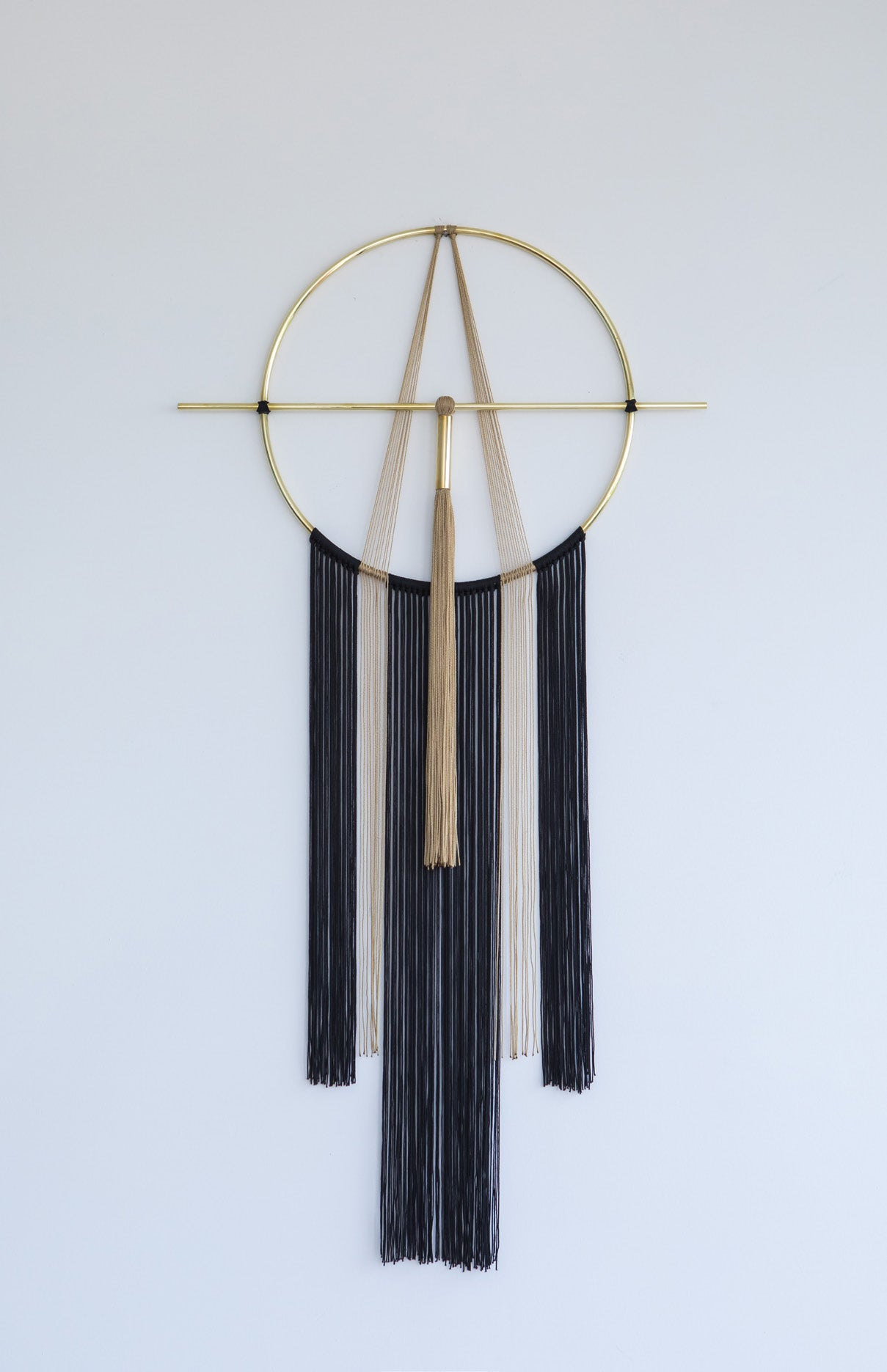 Brass and nylon wall hanging black and ochre brown