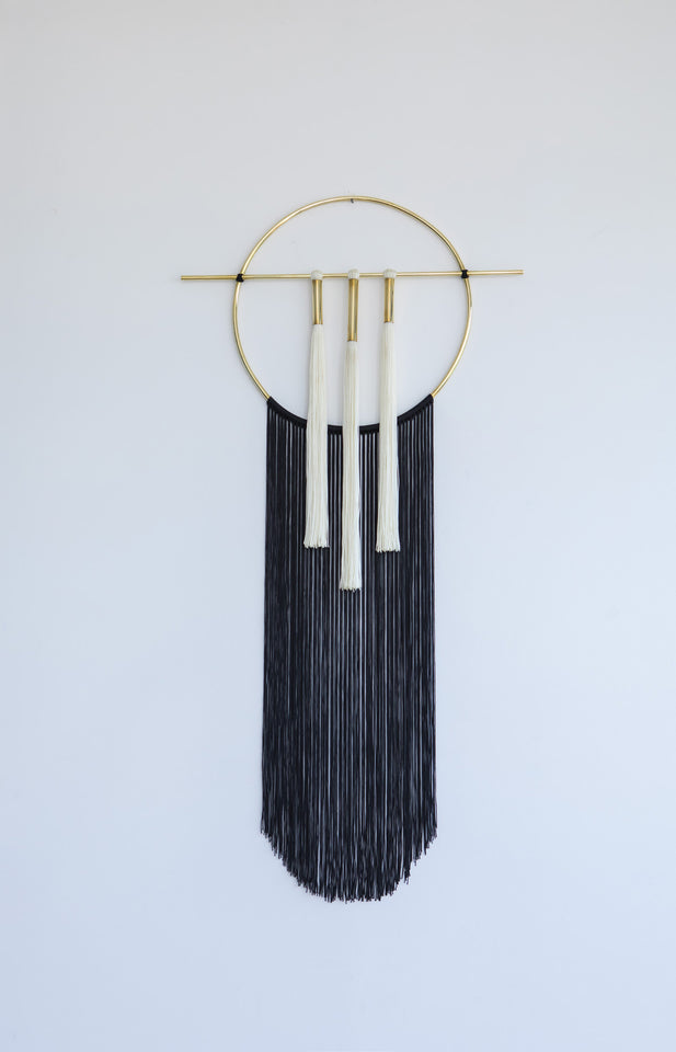 Brass and nylon wall hanging black and white B&W