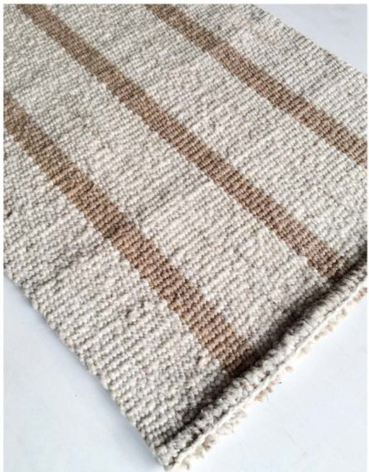 Handwoven wool rug beige and white
