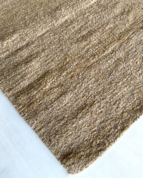 Handwoven wool rug brown