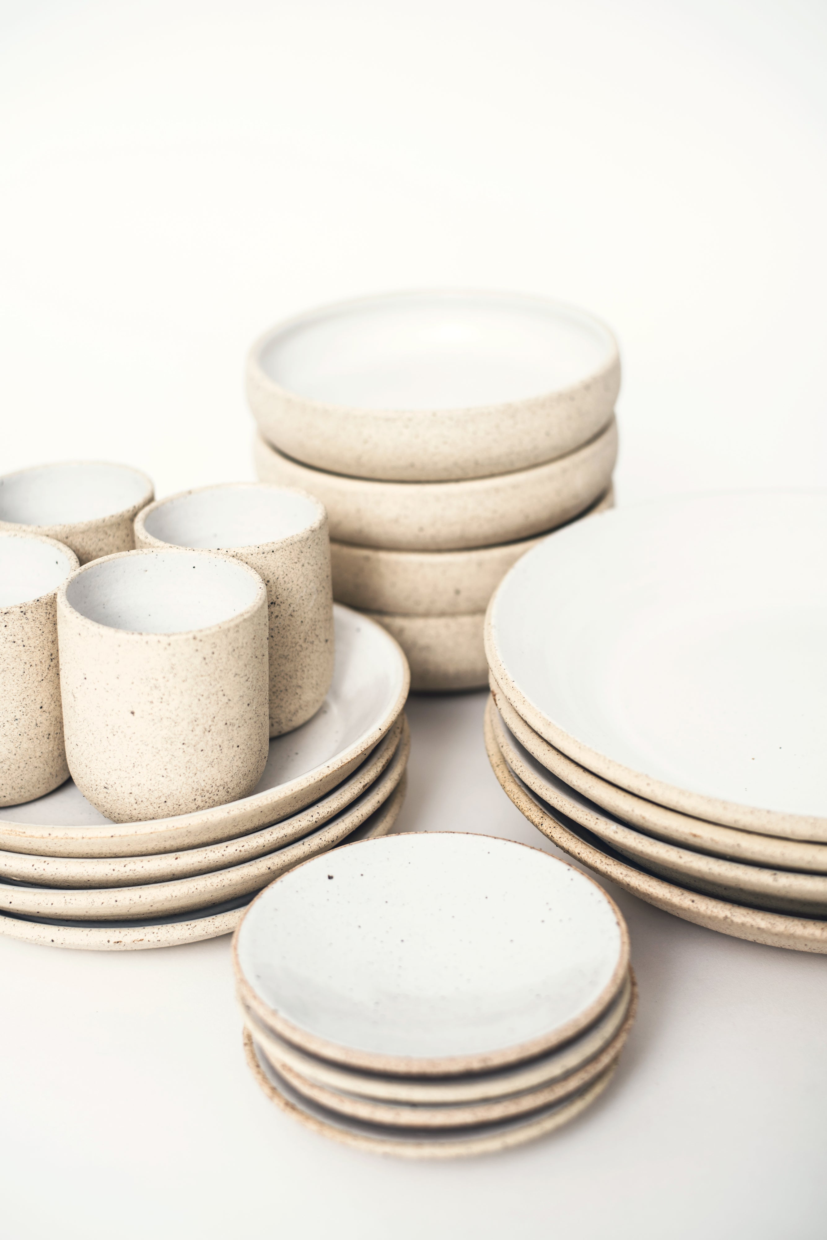 Handmade ceramic plates cups bowls ivory white organic texture