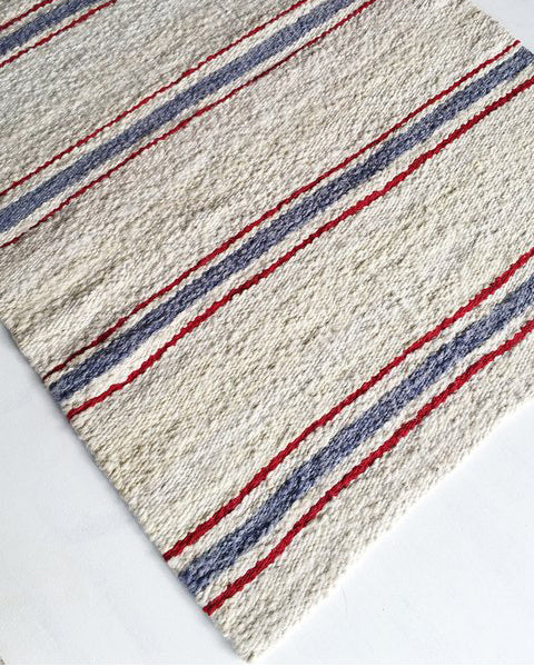Handwoven wool rug white blue red